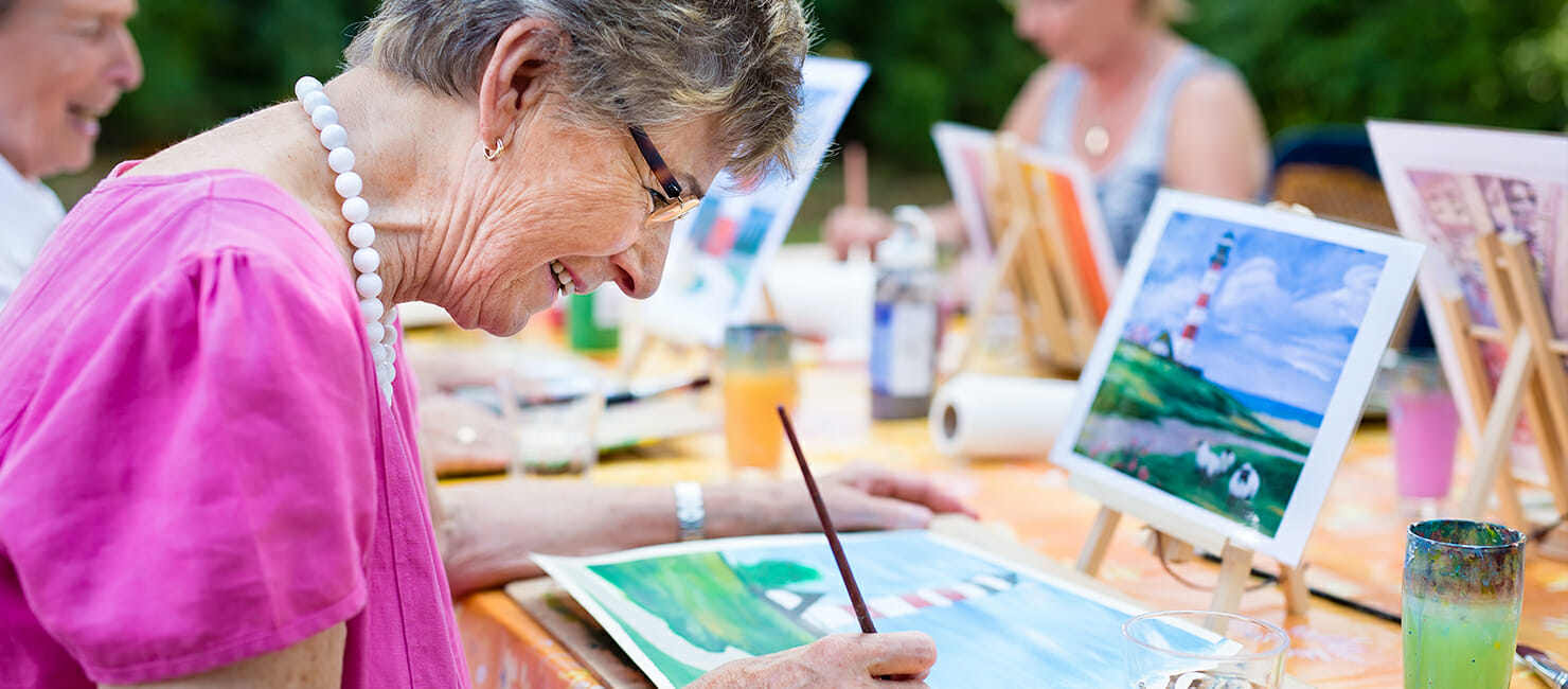 Elderly people painting
