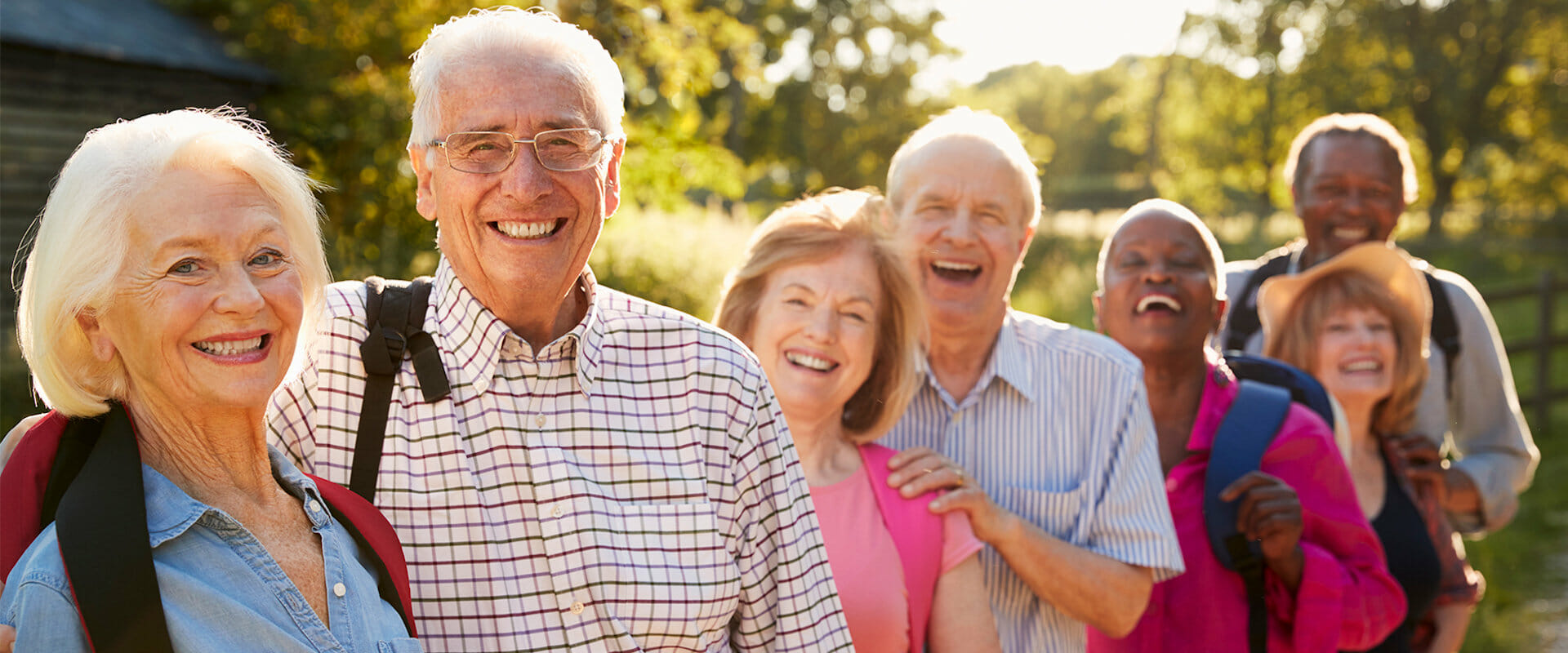 Smiling elderly people outside